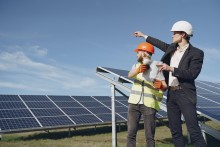 2 men standing by a solar panel array